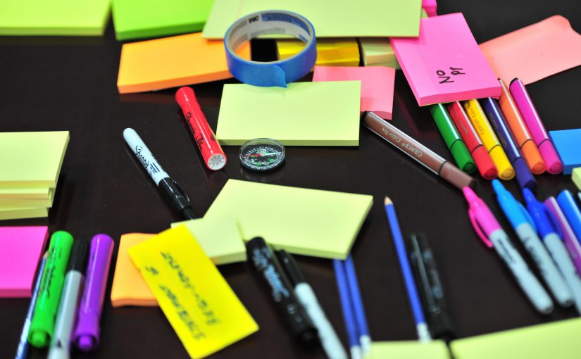 photo-of-sticky-notes-and-colored-pens-scrambled-on-table-632470